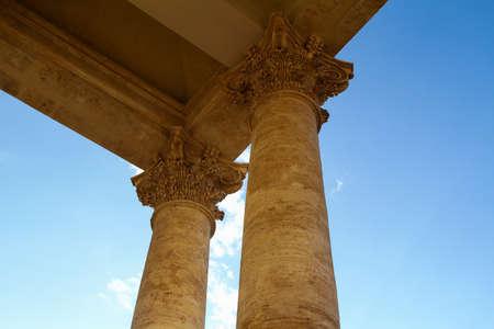 Corinthian columns seen from below. Piazza del Popolo in Rome, church of Santa Maria dei miracoli.