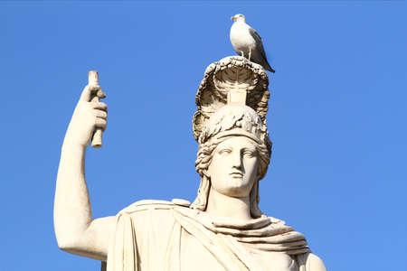 Statue of the goddess Minerva with seagull. Piazza del Popolo in Rome.