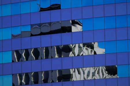 Reflection of mirrored buildings in the Eur district of Rome