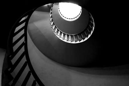 Bottom view of spiral staircase. Black and white photo.