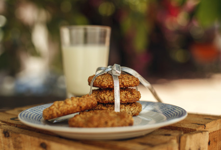 robbon: Homemade organic oatmeal and banana cookies with milk on the plate