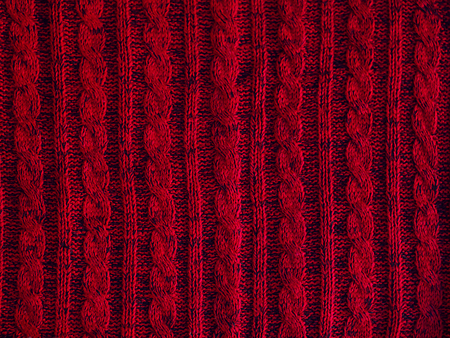 ovine: Knitted pattern background, part of beautiful red sweater. Hobbies. Knitted ornament. Copy space