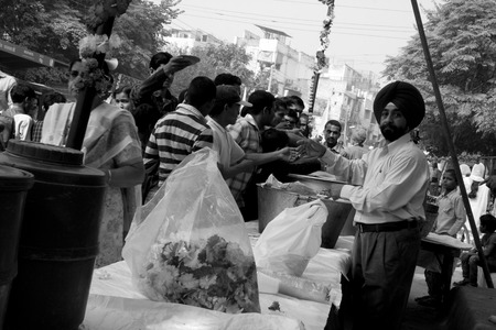 food distribution: Guru Nanak Jayanti celebration in Delhi, India
