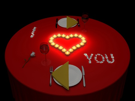 Romantic supper at candles on a black background