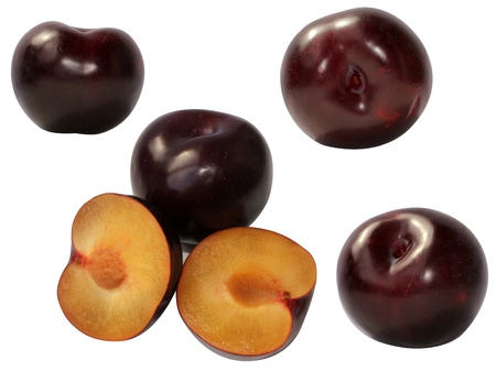 fresh plums some pieces isolated on white background Stock Photo
