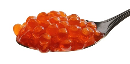 Spoon ful of red caviar on a white background  photo