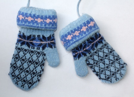 Little baby , accessories mittens-gloves  Stock Photo