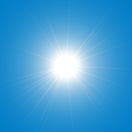 against the sun: The sun shining brightly against the blue sky