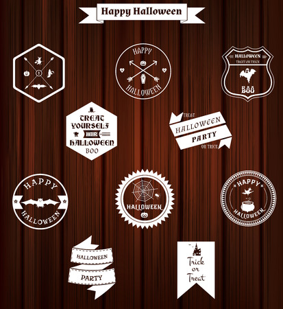 set of halloween badges and labels on wooden background Vector