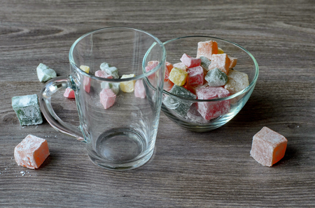 locum: Empty transparent cup and sweet Turkish delight