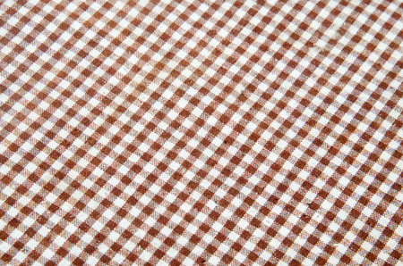 gingham: Trendy checkered gingham textile of brown color