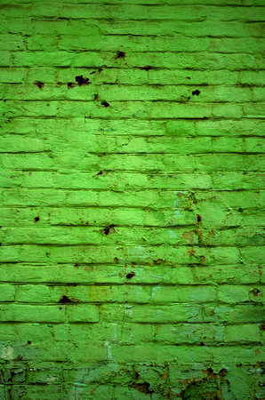 Texture of old green brick wall surface with cement and concrete seams Stock Photo