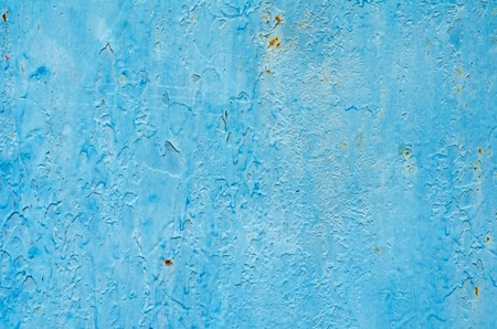 Texture of vintage blue and turquoise painted iron wall background with many layers of paint