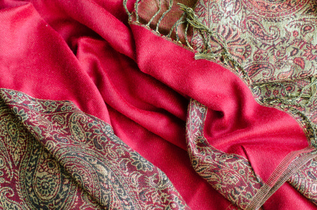Texture of cashmere pashmina textile red and golden colors