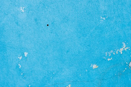Cement painted wall background, baby-blue pastel color
