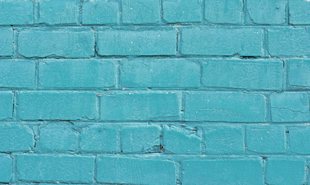 Texture of old blue brick wall surface with cement seams Imagens