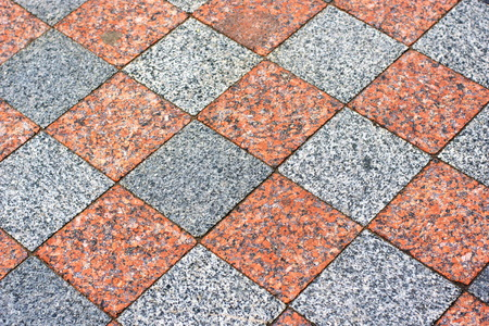 Tiled mosaic concrete pavement of the road background Imagens
