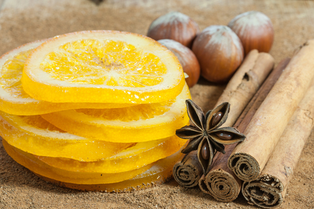 dried orange: Dried orange slices with cinnamon and hazelnuts