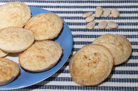 free dish: Almond cookies on a plate and on the tablecloth