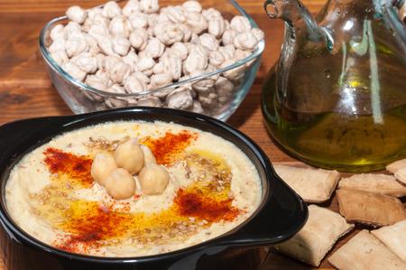 hummus: Plate of hummus and various ingredients Stock Photo