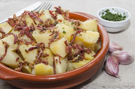 clay pot: Clay pot with potatoes and ham Stock Photo