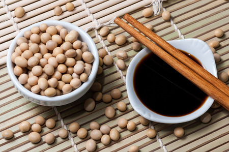 soy sauce: A bowl with soy sauce and One with soybeans