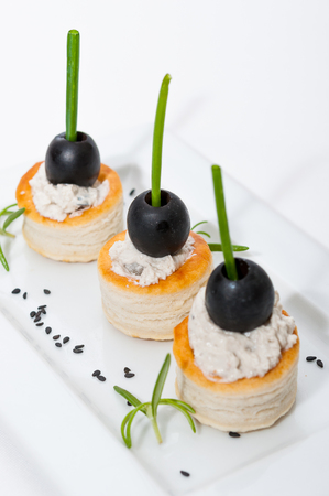 black olives: Volovanes canapes cream cheese and black olives Stock Photo