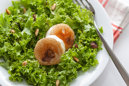 queso de cabra: Lettuce salad, goat cheese, raisins and pine nuts