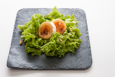 pine nuts: Lettuce salad, goat cheese, raisins and pine nuts