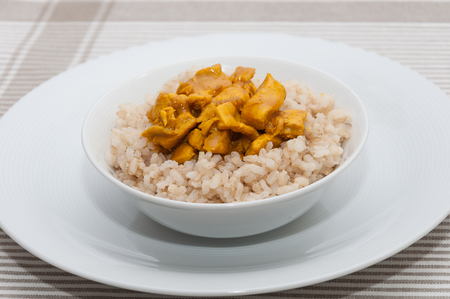 rice plate: Rice with chicken curry in a bowl
