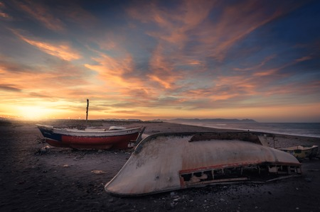 Abandoned boats on the beach while dawn Stock Photo