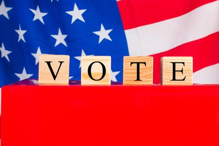 balloting: Ballot box elections on the American flag