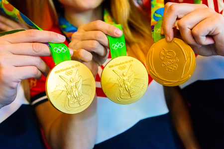 the olympic games: MOSCOW, RUSSIA - AUGUST 24, 2016: Meeting with the russian women handball team.Gold medals of Olympic Games in Rio demonstration
