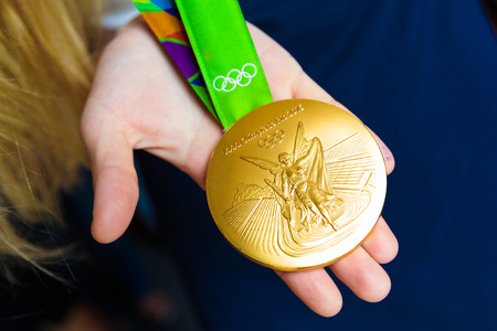 olympic games: MOSCOW, RUSSIA - AUGUST 24, 2016: Meeting with the russian women handball team.Gold medals of Olympic Games in Rio demonstration