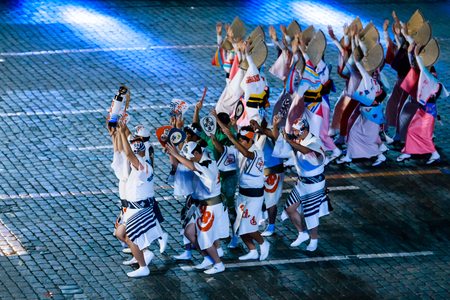 """MOSCOW, RUSSIA - AUGUST 26, 2016: Spasskaya Tower international military music festival. The Japanese Folklore group """"Awa Odori"""" at the Red Square"""