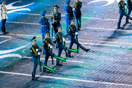 """MOSCOW, RUSSIA - AUGUST 26, 2016: Spasskaya Tower international military music festival. The Honor Guard and the Band of the Presidential Regiment """"Aibyn"""" of Republic of Kazakhstan at the Red Square"""