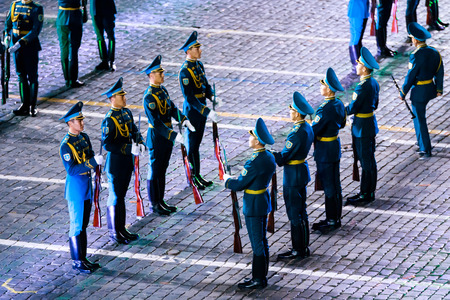 "MOSCOW, RUSSIA - AUGUST 26, 2016: Spasskaya Tower international military music festival. The Honor Guard and the Band of the Presidential Regiment ""Aibyn"" of Republic of Kazakhstan at the Red Square"