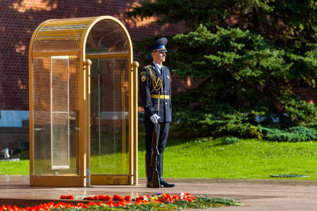 MOSCOW, RUSSIA - SEPTEMBER 02, 2016: Guard of the Presidential regiment of Russia near Tomb of Unknown soldier and Eternal flame in Alexander garden near Kremlin wall
