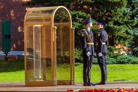 MOSCOW, RUSSIA - SEPTEMBER 02, 2016: Hourly change of the Presidential guard of Russia at the Tomb of Unknown soldier and Eternal flame in Alexander garden near Kremlin wall
