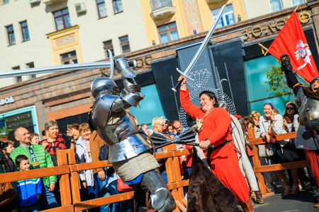 watch city: MOSCOW, RUSSIA - SEPTEMBER 10, 2016: Moscow City Day, 869 anniversary of the city. Performance on Tverskaya Street. Installation dedicated to the Night watch cinema.