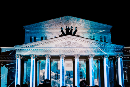 MOSCOW, RUSSIA - SEPTEMBER 24, 2016: The Circle of Light Moscow international festival. State Academic Bolshoi Theatre of Opera and Ballet illuminated for free open air perfomance.