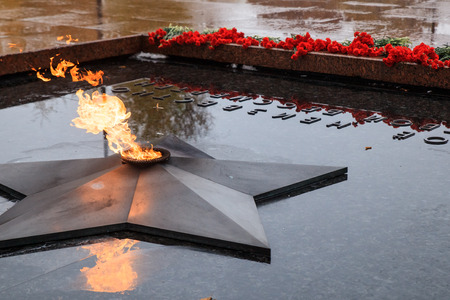 Winter view of the Tomb of Unknown soldier and Eternal flame in Alexander garden near Kremlin wall in Moscow, Russia. Editorial