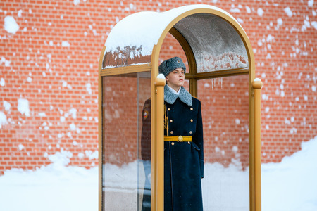 MOSCOW, RUSSIA - JANUARY 05, 2017: Guard of the Presidential regiment of Russia near Tomb of Unknown soldier and Eternal flame in Alexander garden near Kremlin wall. Winter view.