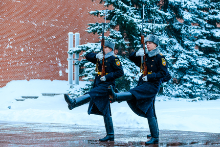 MOSCOW, RUSSIA - JANUARY 05, 2017: Hourly change of the Presidential guard of Russia at the Tomb of Unknown soldier and Eternal flame in Alexander garden near Kremlin wall. Winter view.