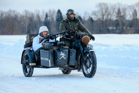 NELIDOVO, MOSCOW REGION, RUSSIA - JANUARY 22, 2017: Reconstruction of the winter defensive battles of the Red Army of the 1st Ukrainian Front in WWII called Battlefield. Hot snow (1944 year). Wehrmacht motorcyclists.