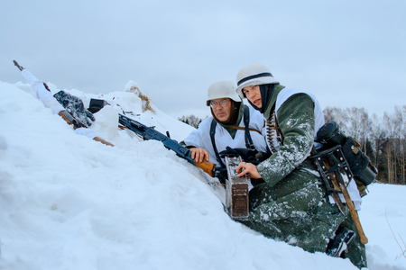 NELIDOVO, MOSCOW REGION, RUSSIA - JANUARY 22, 2017: Reconstruction of the winter defensive battles of the Red Army of the 1st Ukrainian Front in WWII called Battlefield. Hot snow (1944 year). Wehrmacht machine-gun crew.