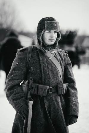NELIDOVO, MOSCOW REGION, RUSSIA - JANUARY 22, 2017: Reconstruction of the winter defensive battles of the Red Army of the 1st Ukrainian Front in WWII called Battlefield. Hot snow (1944 year). Portrait of the Red Army soldier. Black and white photo.