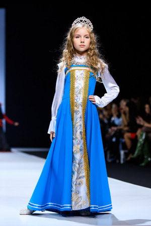 famous industries: MOSCOW, RUSSIA - OCTOBER 19, 2016: Model walk runway for WORLD RUSSIAN BEAUTY catwalk at Spring-summer 2017 Moscow Fashion Week. Clothes in national ethnic style.