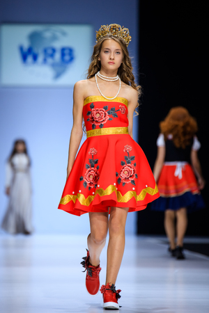 MOSCOW, RUSSIA - OCTOBER 19, 2016: Model walk runway for WORLD RUSSIAN BEAUTY catwalk at Spring-summer 2017 Moscow Fashion Week. Clothes in national ethnic style.