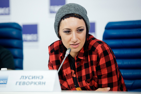 debating: MOSCOW, RUSSIA - FEBRUARY 28, 2017: LOUNA band press-conference at TASS Russian news agency on February 28, 2017 in Moscow, Russia. Singer Lusine Gevorkyan.